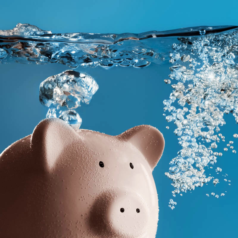 Piggy bank under water with air bubbles.