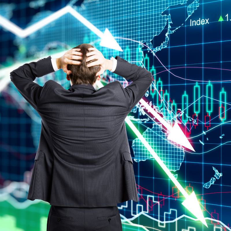 A stressed man reacting to declining stock market.
