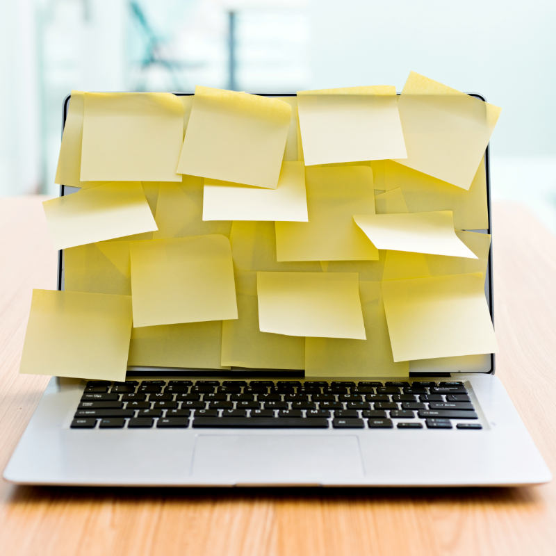 Laptop screen completely covered with yellow post its.