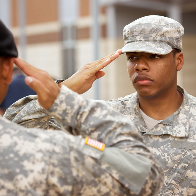 A young soldier salutes.