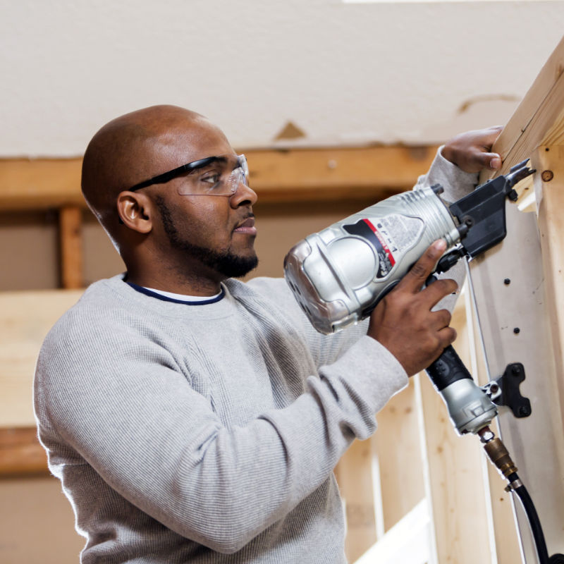 Man using a drill for home renovation.