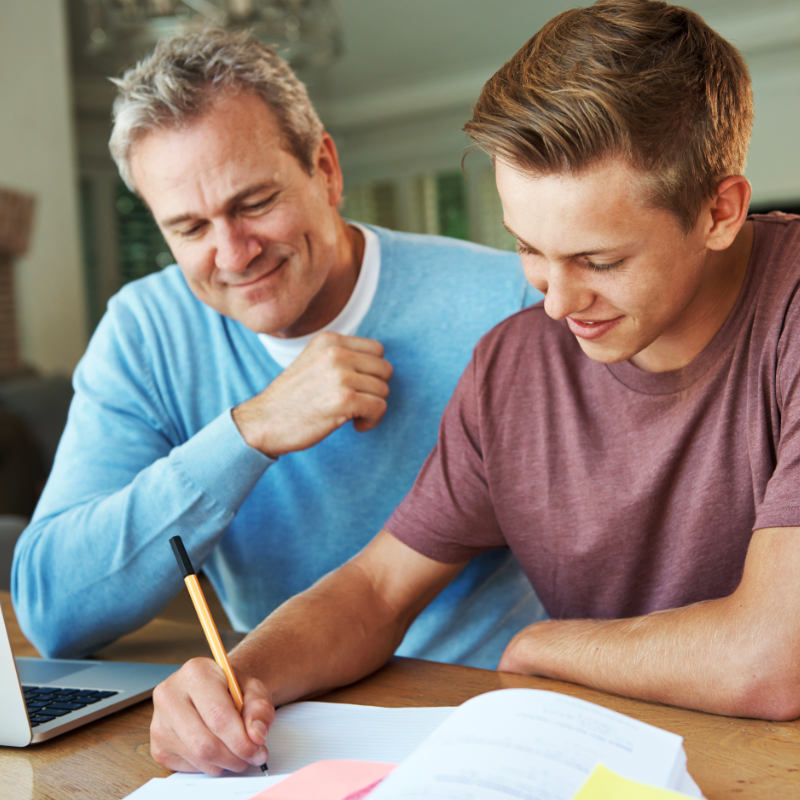 Father helping with son wtih homework.