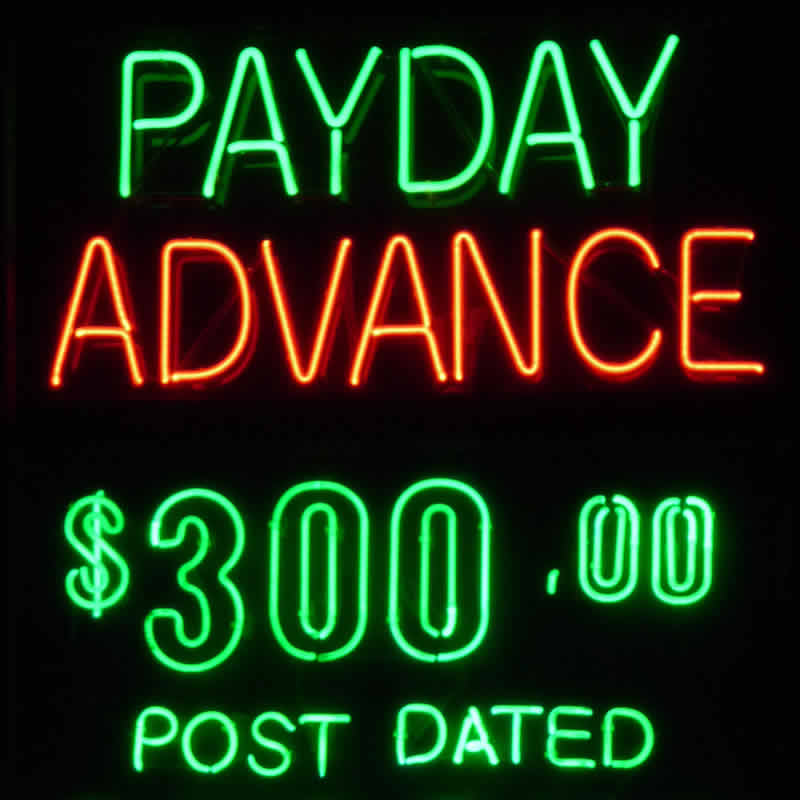A neon payday advance sign