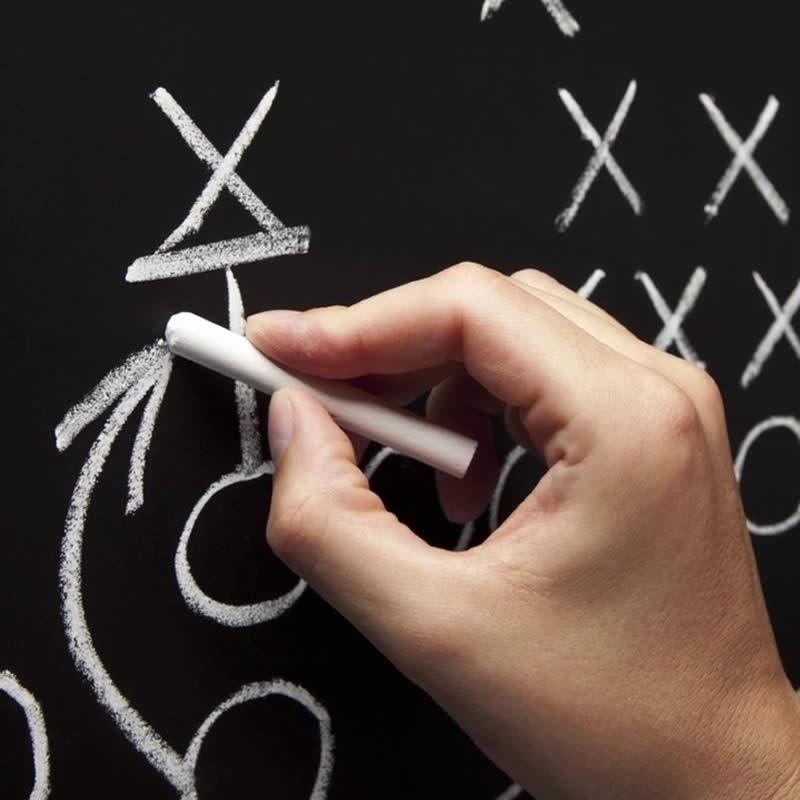 Coach Writing Play on Chalkboard