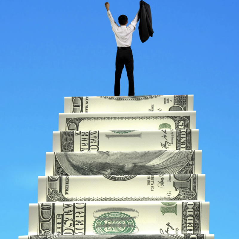 Man on the top of a staircase made with a dollar bill.