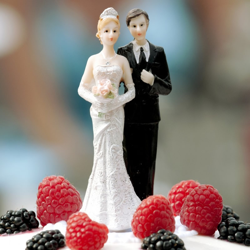 Groom and Bride Cake Toppers on cake.