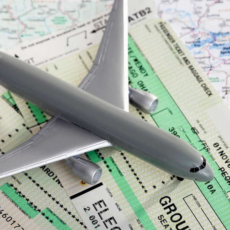 Small model airplane on airline tickets