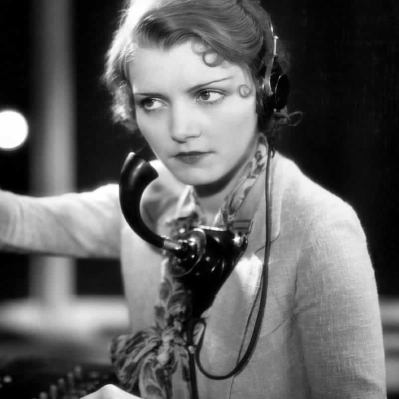 Vintage photo of woman telephone operator.