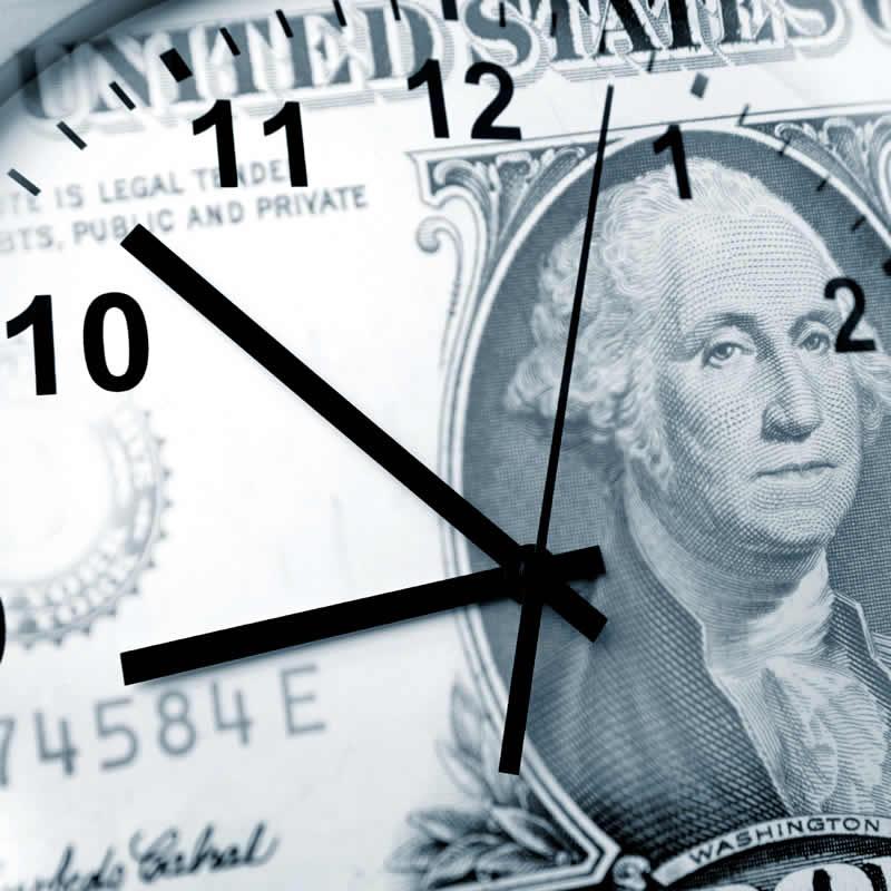 Clock superimposed onto a dollar bill.