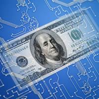 $100 bill on computer circuit board
