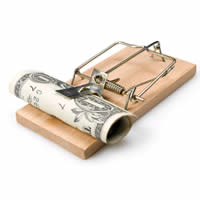 A dollar bill is bait in a mouse trap.
