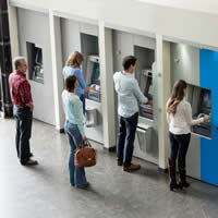 People line up to withdraw money from ATMs.