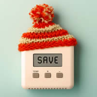 A thermostat with a wool cap and the word SAVE on the display.