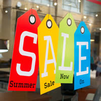 A SALE sign in a store window.