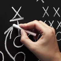 Coach Writing Play on Chalkboard