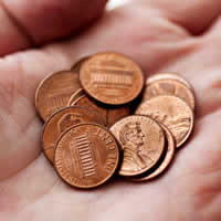 Open hand with pennies.