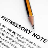 A Promissory Note with sharp pencil on it.