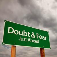 Road Sign that says Doubt and Fear Just Ahead.