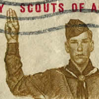 Boy Scout in uniform with hand raised for Scout Pledge. Boy Scouts written above.